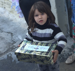 small girl with shoebox