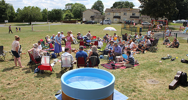 baptismal pool and crowd on the green