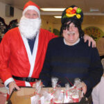 Father Christmas and 'Carmen Miranda' at the Bussage Christmas party