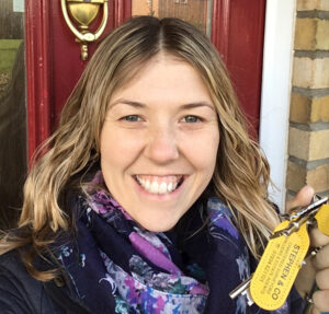 Claire with the keys to her new house!
